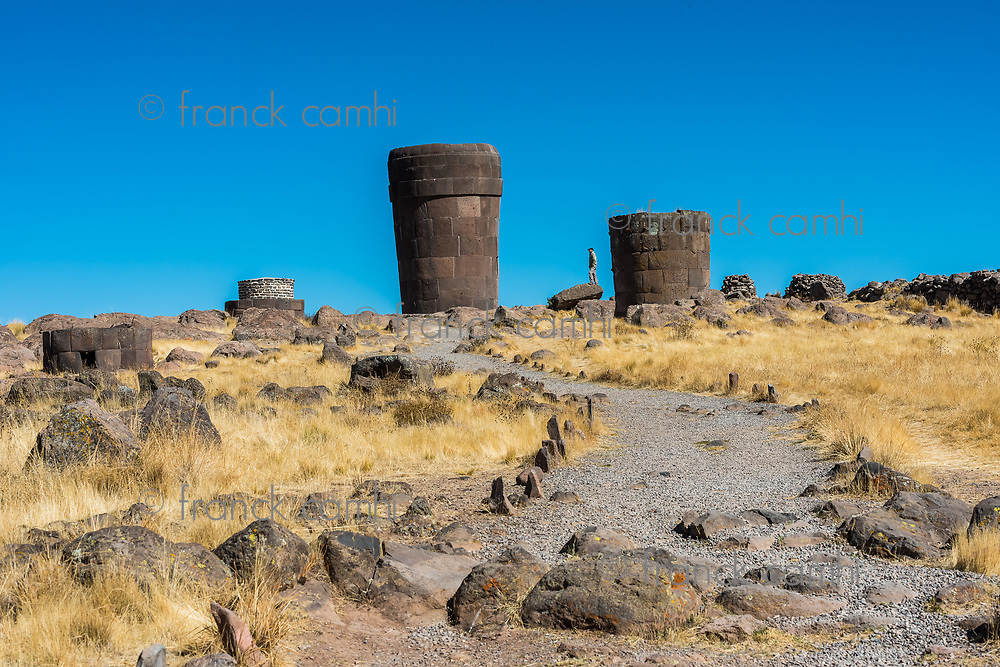 Tourist at the Silustani tombs in the peruvian Andes at Puno Peru