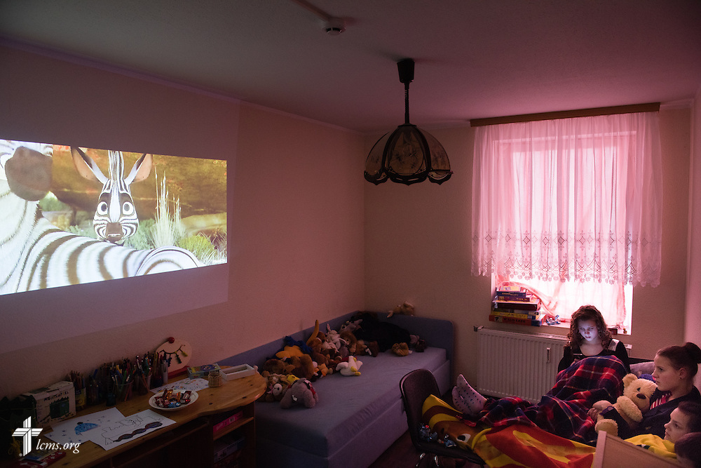 Children and teenagers at the Diaconia daycare center under the Evangelical Lutheran Church in Lithuania watch a movie together on Friday, Feb. 6, 2015, in rural Skirsnemune, Lithuania. LCMS Communications/Erik M. Lunsford
