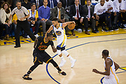 Golden State Warriors guard Stephen Curry (30) dribbles behind his back as Cleveland Cavaliers guard Iman Shumpert (4) reaches for the ball during Game 2 of the NBA Finals at Oracle Arena in Oakland, Calif., on June 4, 2017. (Stan Olszewski/Special to S.F. Examiner)