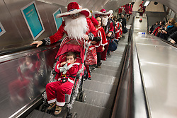 © Licensed to London News Pictures./14/2013. London, UK. Participants dressed in Father Christmas costumes gather for the annual Santacon celebration at Euston Station.Photo credit : Peter Kollanyi/LNP