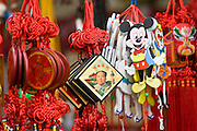 Souvenirs including Chairman Mao keyrings and Mickey Mouse toys on sale at Mount Baoding, China