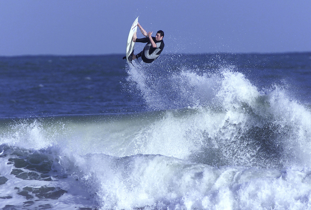 A surfer flying off a wave at Fitzroy Beach in New Plymouth, New Zealand, November 09, 2002. Credit:SNPA / Rob Tucker
