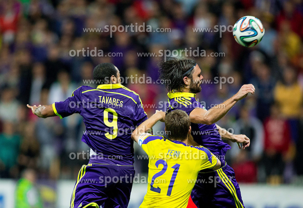 Marcos Tavares #9 of Maribor and Marko Suler #4 of Maribor vs Sheran Yeini of Maccabi during football match between NK Maribor and Maccabi Tel Aviv FC (ISR) in Third qualifying round of UEFA Champions League on July 30, 2014 in Stadium Ljudski vrt, Maribor, Slovenia. Photo by Vid Ponikvar / Sportida.com