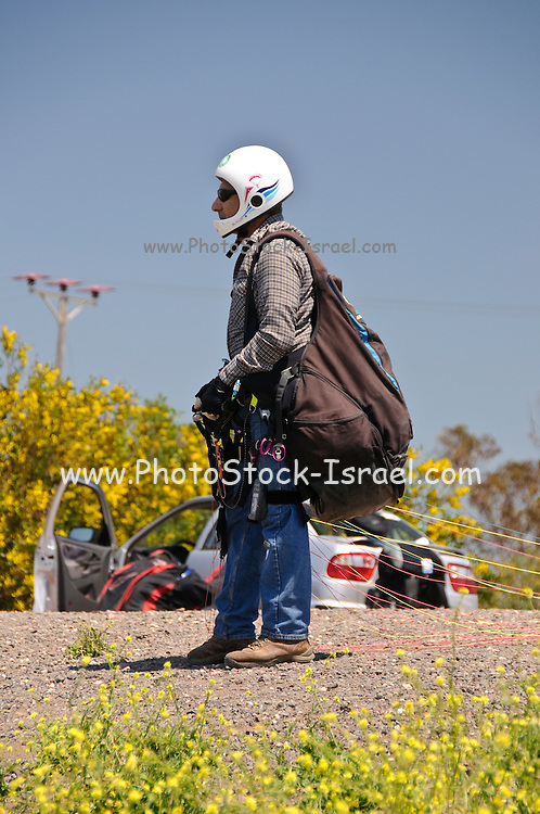 Israel, Golan Heights, paragliding Paraglider preparing his gear before take off