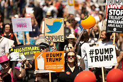 """© Licensed to London News Pictures . 13/07/2018. London, UK. Twitter placard reading """" Stop Hate """" . Demonstrators march from Portland Place to Trafalgar Square in protest against US President Donald Trump's UK visit . Photo credit: Joel Goodman/LNP"""