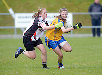 Clare's Captain Chloe Moloney breaks through despite efforts from Sligo's  Aimee Oates in the All ireland U14 C championship final in Kilkerrin-Galway Photo: Andrew Downes..
