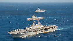 PHILIPPINE SEA (Aug. 26, 2018) The amphibious assault ship USS Wasp (LHD 1) and the amphibious dock landing ship USS Ashland (LSD 48), both a part of the Wasp Amphibious Ready Group (ARG), are underway  alongside the Japan Maritime Self-Defense Force (JMSDF) amphibious transport dock ship JS Osumi (LST 4001) during a passing exercise (PASSEX) in the Philippine Sea, Aug. 26, 2018. PASSEX enabled the Wasp ARG and the JMSDF a chance to practice communications and maneuvering procedures. The Wasp ARG is currently operating in the region to enhance interoperability with partners and serve as a ready-response force for any type of contingency. (U.S. Navy photo by Mass Communication Specialist 3rd Class Taylor King/Released)180826-N-NM806-0731