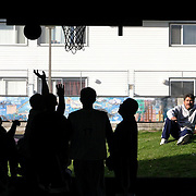 OAXACA BASKETBALL.Basketball players, many used to living in the shadows of American society, compete during a basketball match on Sunday October 9, 2005 at a park in Seattle. Men from Oaxaca and other Mexican states gather with their families and friends every Sunday for basketball at the park.  They bring a bit of their culture with them and for an afternoon most  couldn't tell they were not in their native Mexican state.  Joshua Trujillo / Seattle Post-Intelligencer