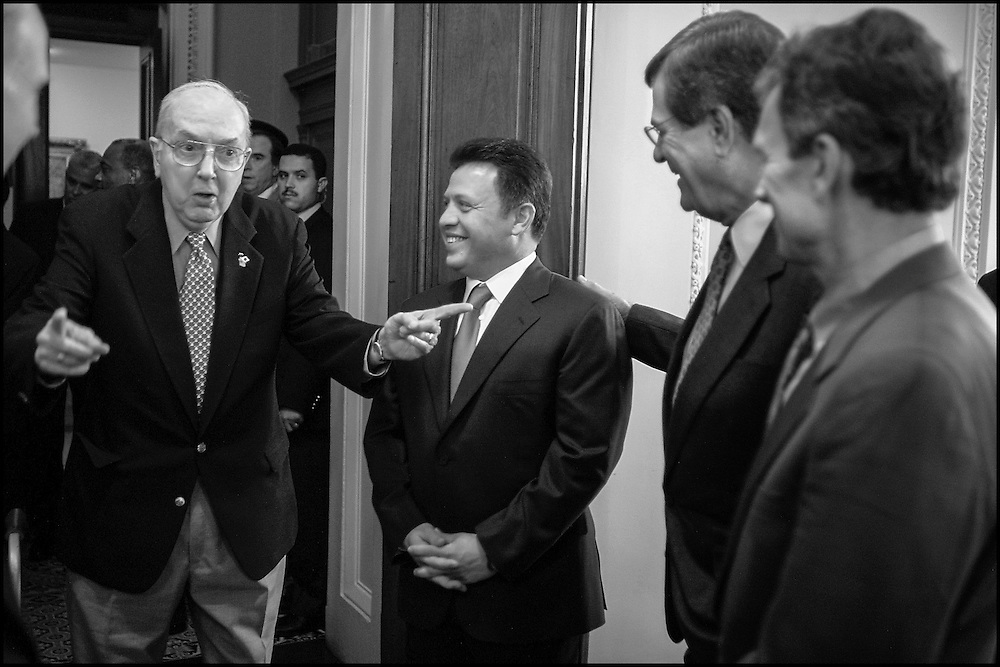 Sen. Jesse Helms enters the room to greet King Abdullah of Jordan.  Sens. Trent Lott and Tom Daschle are to the right in the photo.  9/27/01..©PF BENTLEY/PFPIX.com