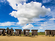 06 NOVEMBER 2014 - SITTWE, RAKHINE, MYANMAR: A row of latrines in an IDP camp for Rohingya Muslims near Sittwe. After sectarian violence devastated Rohingya communities and left hundreds of Rohingya dead in 2012, the government of Myanmar forced more than 140,000 Rohingya Muslims who used to live in and around Sittwe, Myanmar, into squalid Internal Displaced Persons camps. The government says the Rohingya are not Burmese citizens, that they are illegal immigrants from Bangladesh. The Bangladesh government says the Rohingya are Burmese and the Rohingya insist that they have lived in Burma for generations. The camps are about 20 minutes from Sittwe but the Rohingya who live in the camps are not allowed to leave without government permission. They are not allowed to work outside the camps, they are not allowed to go to Sittwe to use the hospital, go to school or do business. The camps have no electricity. Water is delivered through community wells. There are small schools funded by NOGs in the camps and a few private clinics but medical care is costly and not reliable.   PHOTO BY JACK KURTZ