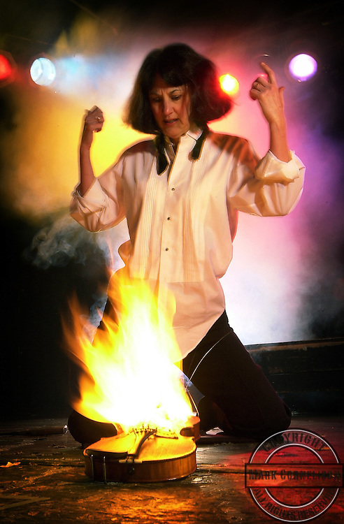 Merrilee Elliott, of the Lexington Philharmonic does a Jimi Hendrix   imitation of the burning violin ( a la Jimi in Monterrey) on tuesday January   28, 2003 in Lexington,Kentucky.   The cover of one of Rolling  Stone  magazine's 20th-anniversary issues features an enduring image of          the  Sixties: Jimi Hendrix fanning the flames on his guitar after torching  it at  the conclusion of his scorching performance at the Monterey (Calif., U.S.)  Pop Festival on June 18, 1967.