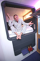 Launch of Yo!tel in Gatwick airport. Simon Woodroffe in pyjamas in a Yo!tel room.
