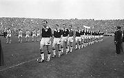 Teams line out onto the pitch before the All Ireland Senior Gaelic Football Championship Final Dublin v Galway in Croke Park on the 22nd September 1963. Dublin 1-9 Galway 0-10.