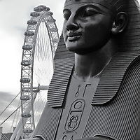 Foreground: Sphinx; background London Eye ferris wheel. One of two sphinxes flanking Cleopatra's Needle. Mounted 1882. Designed by George Vulliamy and modelled by C. H. Mabey.