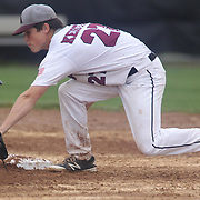 Caravel Academy infielder Kevin Keister (27) makes the tag at second base in the mist of the second round of the DIAA baseball state tournament between#4 Caravel Academy and #15 St. Elizabeth Saturday May 27, 2017, at Caravel Academy in Bear Delaware.