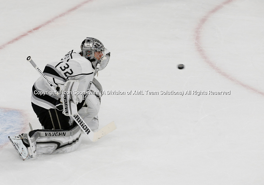 LAS VEGAS, NV - APRIL 11: Los Angeles Kings goaltender Jonathan Quick (32) watches a puck approach the goal during Game One of the Western Conference First Round of the 2018 NHL Stanley Cup Playoffs between the L.A. Kings and the Vegas Golden Knights Wednesday, April 11, 2018, at T-Mobile Arena in Las Vegas, Nevada. The Golden Knights won 1-0.  (Photo by: Marc Sanchez/Icon Sportswire)