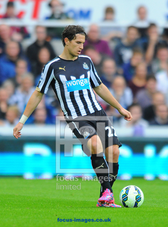 Daryl Janmaat of Newcastle United passes the ball during the Barclays Premier League match at St. James's Park, Newcastle<br /> Picture by Greg Kwasnik/Focus Images Ltd +44 7902 021456<br /> 18/10/2014