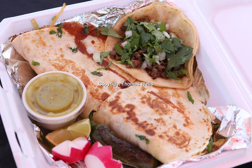 A steak quesadilla and a steak taco