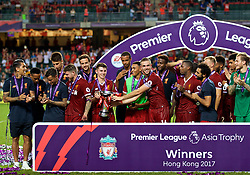 HONG KONG, CHINA - Saturday, July 22, 2017: Liverpool's captain Jordan Henderson hands the trophy to Ben Woodburn during the Premier League Asia Trophy final match between Liverpool and Leicester City at the Hong Kong International Stadium. (Pic by David Rawcliffe/Propaganda)