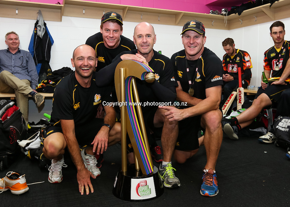 Wellington Firebirds coach Jamie Siddons and his coaching staff pose with the Georgie Pie Super Smash T20 cricket trophy after the Firebirds win the Georgie Pie Super Smash T20 cricket Final - Firebirds v Aces at Seddon Park, Hamilton, New Zealand on Sunday 7 December 2014.  Photo: Bruce Lim / www.photosport.co.nz