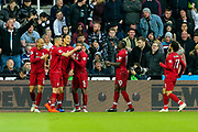 Virgil van Dijk (#4) of Liverpool celebrates Liverpool's first goal (0-1) with Liverpool team mates during the Premier League match between Newcastle United and Liverpool at St. James's Park, Newcastle, England on 4 May 2019.