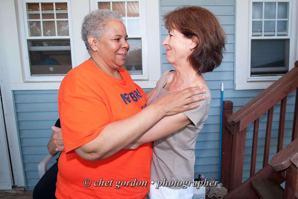 City of Newburgh Councilwoman Gay Lee (left) during a family gathering at her Newburgh, NY home on Saturday, June 13, 2015. Lee has begun her campaign bid for Mayor of Orange County's largest city against incumbent mayor Judy Kennedy, and Jonathan Jacobson, the current Newburgh Democratic Committee Chairman.  © Chet Gordon • Photographer