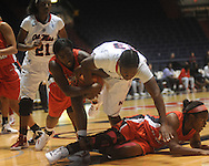 Ole Miss's LaTosha Laws (23) is called for a foul as she battles South Alabama's Mary Nixon (23) and Mansa El (33) for the ball in women's college basketball in Oxford, Miss. on Friday, November 18, 2011.