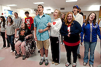 """The S. S. American passengers Michelle Grace (in wheelchair), Sven Gustafson as Lord Evelyn Oakleigh, Teghan Kelly as Hope Harcourt, Kelly Ainsworth as Evangeline Harcourt, Alex Butcher-Nesbit as Elisha Whitney and Nikki Jenkins as Luke practice a song for """"Anything Goes"""" to be performed this weekend at Inter Lakes High School Auditorium.  (Karen Bobotas/for the Laconia Daily Sun)"""