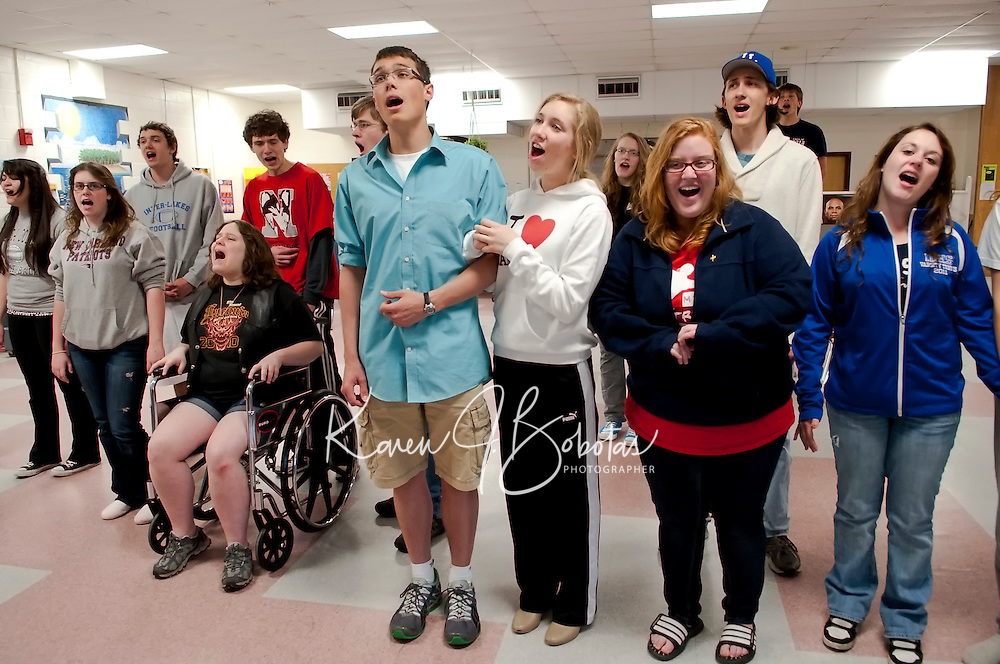"The S. S. American passengers Michelle Grace (in wheelchair), Sven Gustafson as Lord Evelyn Oakleigh, Teghan Kelly as Hope Harcourt, Kelly Ainsworth as Evangeline Harcourt, Alex Butcher-Nesbit as Elisha Whitney and Nikki Jenkins as Luke practice a song for ""Anything Goes"" to be performed this weekend at Inter Lakes High School Auditorium.  (Karen Bobotas/for the Laconia Daily Sun)"