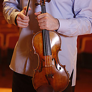 Russian born American violinist Philippe Quint plays Vieuxtemps Guarneri del Ges&ugrave; violin of 1741 in a solo recording performance in the Rudolph Ganz Hall of the Roosevelt University in Chicago June 6, 2010.<br /> Photography by  Jose  More