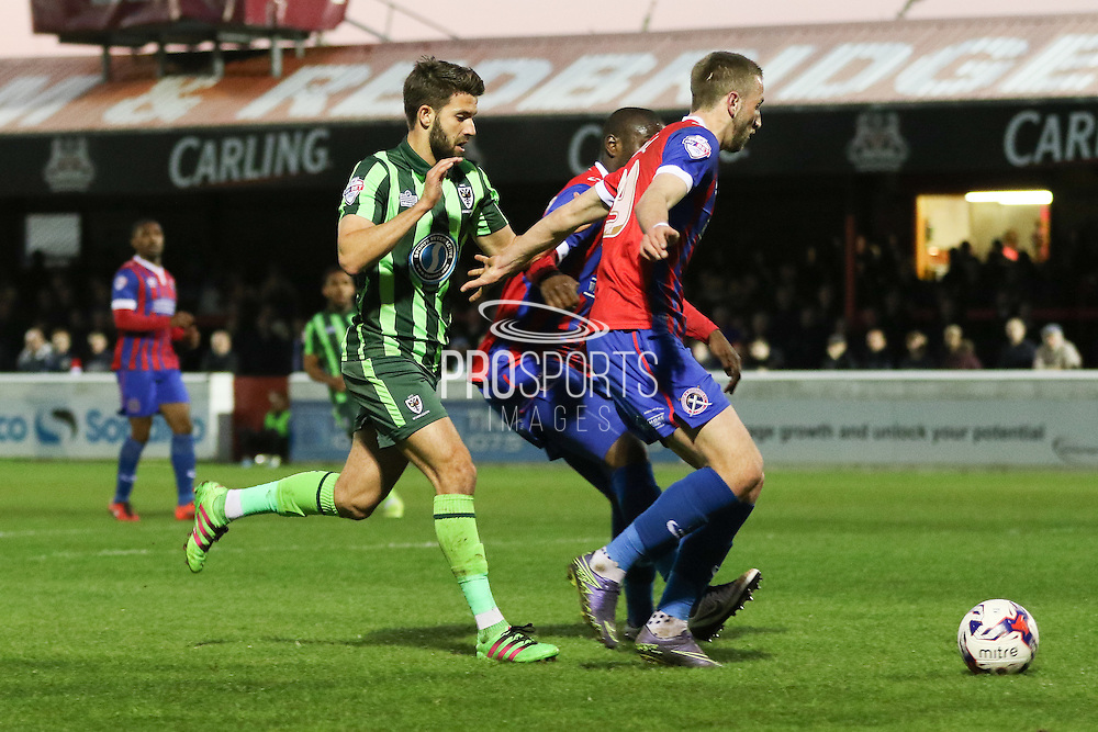 ALuke Pennell defender of Dagenham & Redbridge (29) shields the ball from George Francomb midfielder for AFC Wimbledon (7) during the Sky Bet League 2 match between Dagenham and Redbridge and AFC Wimbledon at the London Borough of Barking and Dagenham Stadium, London, England on 19 April 2016. Photo by Stuart Butcher.