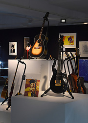 A guitar owned by Prince (front right) and a guitar owned by Jimi Hendrix (centre back) on display ahead of the the Entertainment Memorabilia Sale at Bonhams in Knightsbridge, London later this week.