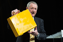 © Licensed to London News Pictures . 15/03/2015 . Liverpool , UK . Ian Wrigglesworth auctions a Liberal Democrat yellow ministerial box at the conference . The Liberal Democrat Party Conference at the Arena and Conference Centre in Liverpool . Photo credit : Joel Goodman/LNP