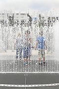 children playing with the fountain in the garden of the Rijksmuseum Amsterdam