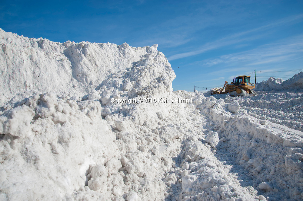 "February 6, 2015 Boston, MA USA:  Boston's largest ""Snow  farm"" used to store snow in Seaport district in Boston, MA.  The snow is dumped here from all over the city. More than 60 inches of snow have fallen in Boston since Christmas."