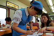 Chinese waitress working in tourist train on golden weeks