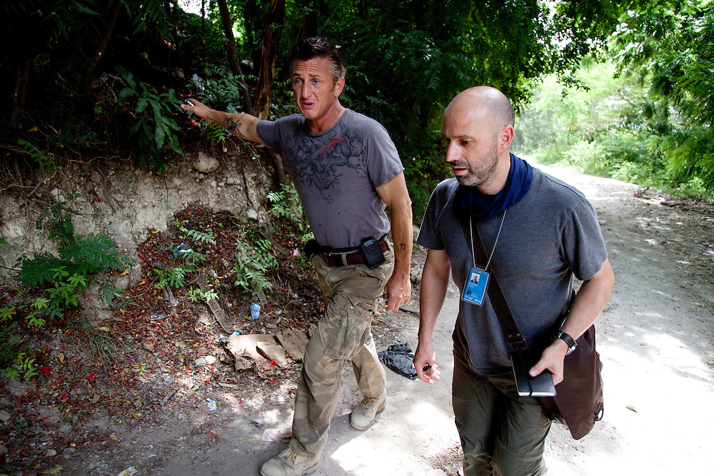 Guseppe Di Grazia(Right) and Sean Penn(Left) walking in the JP HRO camp, a makeshift camp that is home to an estimated 55,000 refugees in Port-au-Prince, Haiti on July 16, 2010. The camp is run by the movie actor Sean Penn.