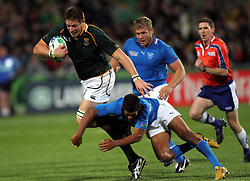 South Africa's Bakkies Botha (left) is tackled by Namibia's Chrysander Botha during the Pool D match at North Harbour Stadium, Auckland, New Zealand,