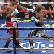 LAS VEGAS, NV - SEPTEMBER 13: Marcos Maidana (L) catches Floyd Mayweather Jr. with a left jab during their WBC/WBA welterweight title fight at the MGM Grand Garden Arena on September 13, 2014 in Las Vegas, Nevada. (Photo by Alex Menendez/Getty Images) *** Local Caption *** Floyd Mayweather Jr; Marcos Maidana