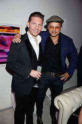 Left to right, NICK CANDY and GERRY DEVEAUX at a party to launch the Autumn/Winter 2013 Candy Magazine held at The Saatchi Gallery, Duke of York's HQ, King's Road, London on 15th October 2013.