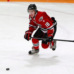 Aurora, ON - Jan 25 : Ontario Junior Hockey League Game Action between the Milton Icehawks and the Aurora Tigers, Shane Bennett #18 of the Milton Ice Hawks Hockey Club skates with the puck during third period game action.<br /> (Photo by Brian Watts / OJHL Images)