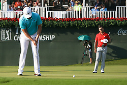 September 23, 2017 - Atlanta, Georgia, United States - Jon Rahm (L) putts the 18th green as Xander Schauffele looks on during the third round of the TOUR Championship at the East Lake Club. (Credit Image: © Debby Wong via ZUMA Wire)