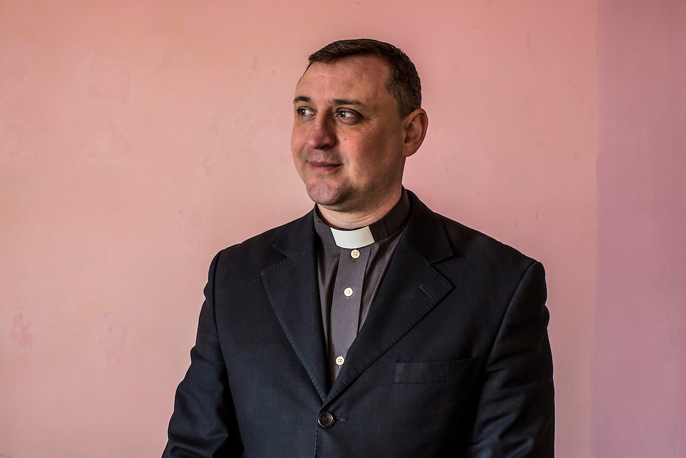 MARIINKA, UKRAINE - FEBRUARY 20, 2016:  Pastor Sergei Kosyak poses for a portrait a service at the Christian Help Center of the Church of the Transfiguration in Mariinka, Ukraine. The Donetsk suburb has been the scene of some of the heaviest fighting recently between Ukrainian forces and pro-Russian rebels. CREDIT: Brendan Hoffman for The New York Times