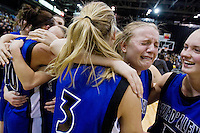 Coeur d'Alene High's Kelsi DeHaas cries tears of joy while leaning on Amanda Buttrey, left, and Dayna Drager after the Viking's win Saturday at the state 5A girls basketball tournament championship game in Nampa. Coeur d'Alene beat the Falcons 61-47.