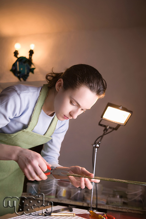 Craftswoman working with glass