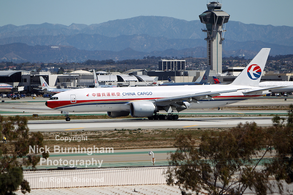 LOS ANGELES, CALIFORNIA, USA - APRIL 17, 2013 - China Cargo Airlines Boeing 777-F6N taxis at Los Angeles Airport on April 17, 2013. It has the most powerful jet engines in commercial service.