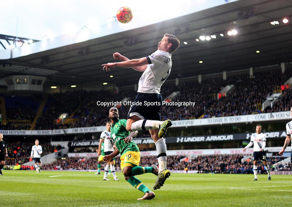 26 December 2015 - Premier League - Tottenham Hotspur v Norwich City<br /> Jan Vertonghen of Spurs heads the ball as Cameron Jerome of Norwich looks on below<br /> Photo: Charlotte Wilson / Offside