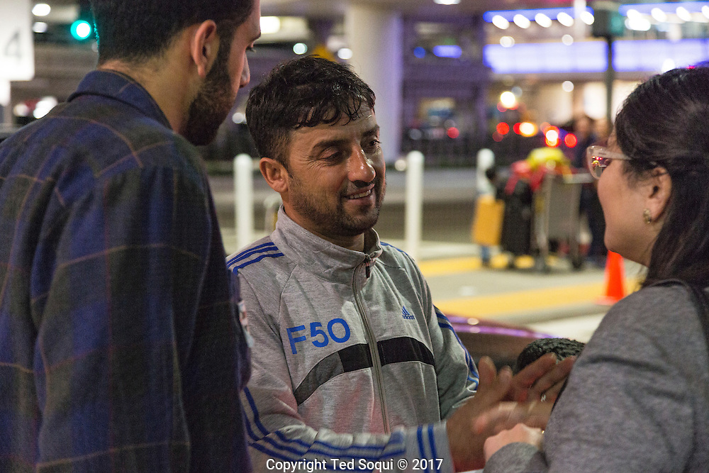 Attaee Abdullah.<br /> Immigrants from countries on the anti-travel Muslim ban return to the US at LAX airport.