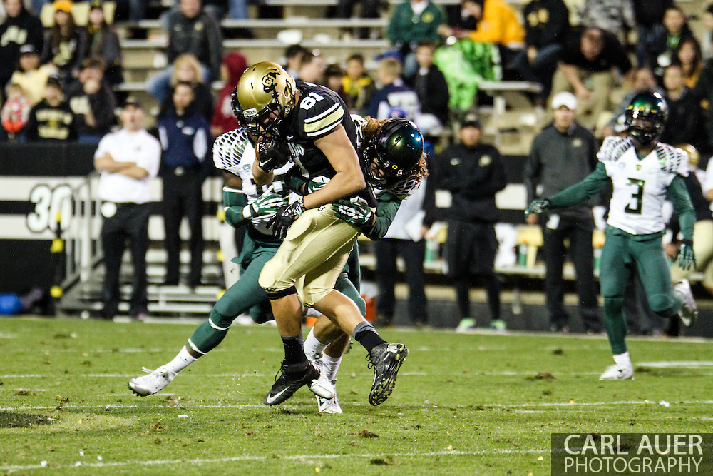 October 5th, 2013:  Colorado Buffaloes freshman tight end Sean Irwin (81) is tackled after catching the ball in the fourth quarter of the NCAA football game between the University of Oregon Ducks and the Colorado Buffaloes at Folsom Field in Boulder, Colorado
