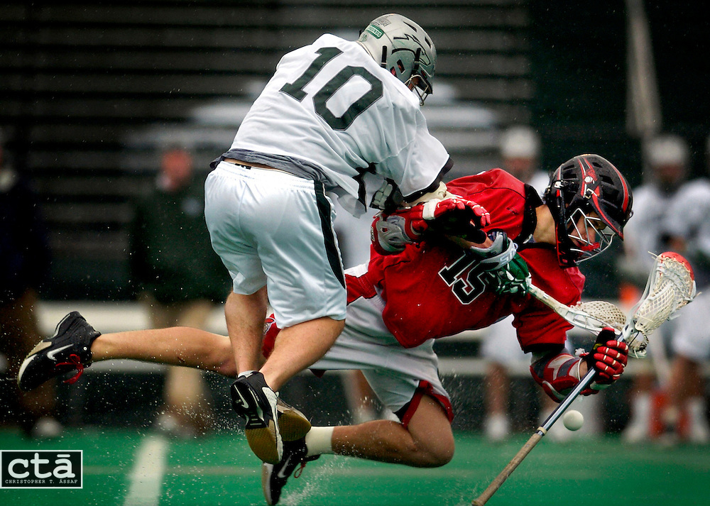 The ball gets away from Rutgers attacker Colin Checcio (15) as he is knocked hard by Loyola midfielder Jordan Rabidou (10) during the first quarter of their game on a cold, rainy Saturday at Loyola. A penalty was called against Rabidou but Rutgers could not capitalize and Loyola led 8-1 at the half. They won 9-4.
